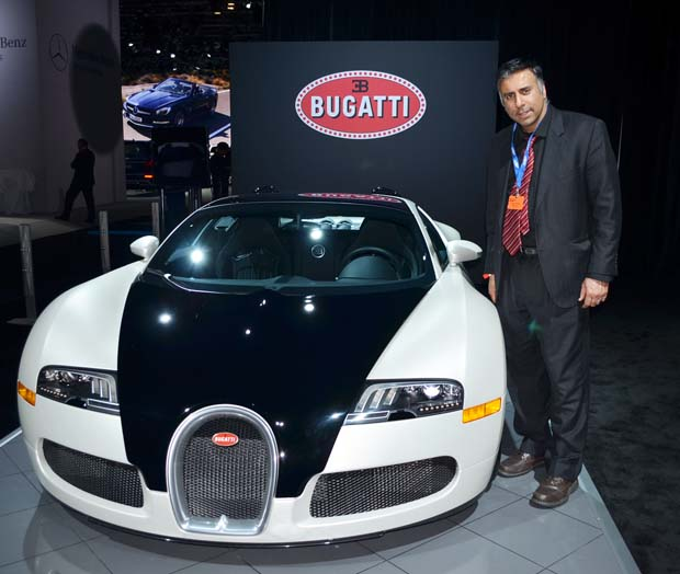 Dr Abbey with the most expensive car of the show Bugatti