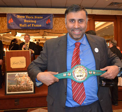 Dr.Abbey holding up Mini WBC Belt