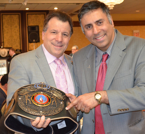 Dr.Abbey with Arthur Mercante Jr holding his fathers hall of Fame belt