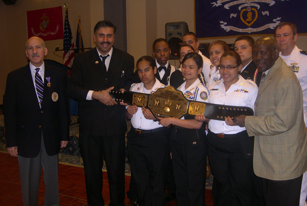 Dr.Abbey with Boxing Belt Posing with Youths