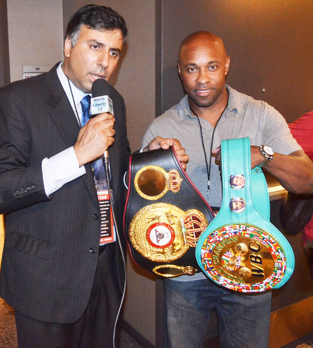 Dr.Abbey with Canelo Alvarez's  WBA & WBC Belts