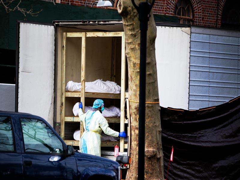 Bodies of COVID-19 People dead  loaded in Jumbo Trucks