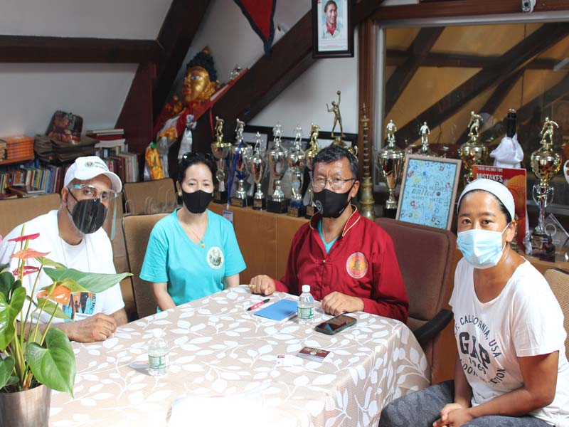 L-R Dr Abbey with Tshering Sherpa ,Mr Sherpa and a volunteer